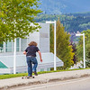 "A skateboarder rolls past the Butrovich Building on UAF's West Ridge on the first day of class of the 2013 fall semester.  <div class=""ss-paypal-button"">Filename: LIF-13-3928-95.jpg</div><div class=""ss-paypal-button-end"" style=""""></div>"