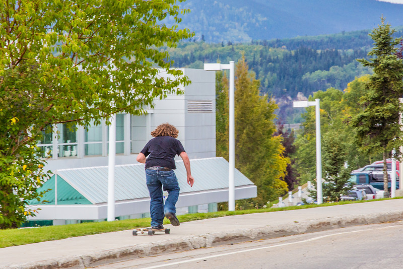 """A skateboarder rolls past the Butrovich Building on UAF's West Ridge on the first day of class of the 2013 fall semester.  <div class=""""ss-paypal-button"""">Filename: LIF-13-3928-95.jpg</div><div class=""""ss-paypal-button-end"""" style=""""""""></div>"""