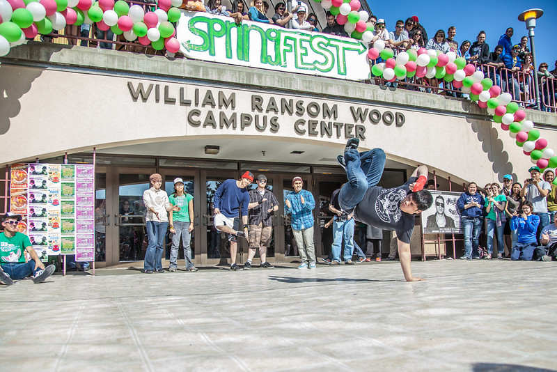 """Dancers help kick off the annual SpringFest celebration in front of the Wood Center.  <div class=""""ss-paypal-button"""">Filename: LIF-12-3373-071.jpg</div><div class=""""ss-paypal-button-end"""" style=""""""""></div>"""
