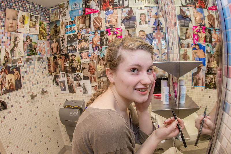 """Music major Kaylie Wiltersen applies some eyeliner in a Skarland Hall bathroom.  <div class=""""ss-paypal-button"""">Filename: LIF-13-3735-122.jpg</div><div class=""""ss-paypal-button-end"""" style=""""""""></div>"""