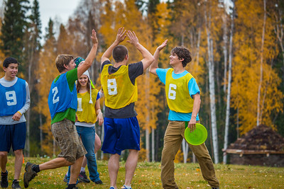 Adam McCombs, #6, celebrates a score with teammates and opponents during an ultimate frisbee scrimmage on campus.  Filename: LIF-12-3557-162.jpg