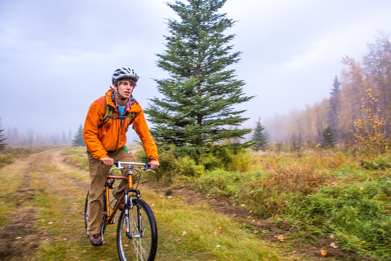 """Mechanical engineering major Adam McCombs rides his bike through the potato field towards campus on a recent foggy morning.  <div class=""""ss-paypal-button"""">Filename: LIF-12-3556-009.jpg</div><div class=""""ss-paypal-button-end"""" style=""""""""></div>"""