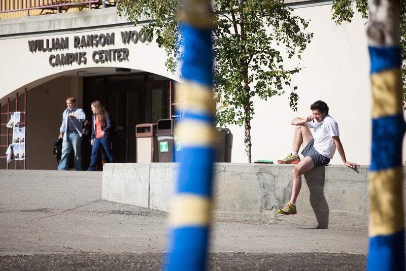 """Trevor Scott speaks on the phone on a sunny day before classes start Tuesday, August 28, 2012 in front of Wood Center.  <div class=""""ss-paypal-button"""">Filename: LIF-12-3518-1.jpg</div><div class=""""ss-paypal-button-end"""" style=""""""""></div>"""
