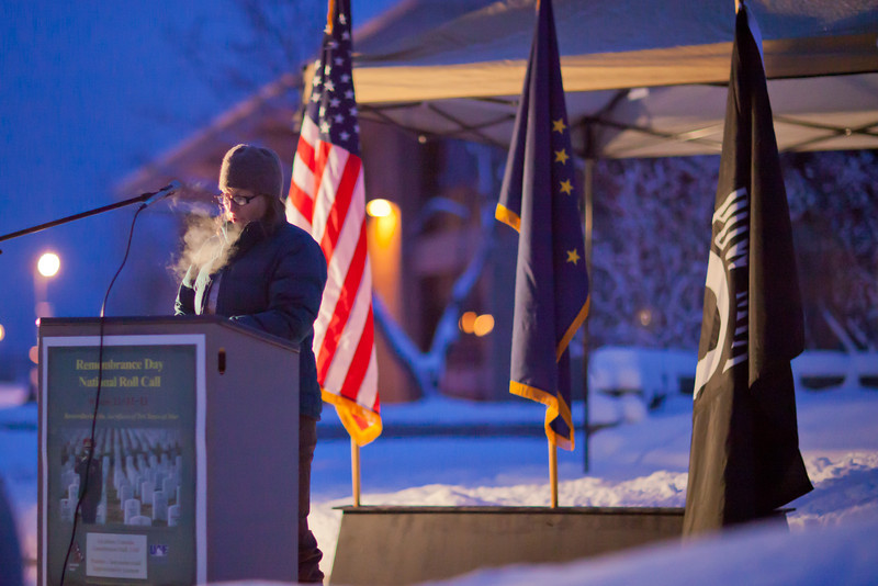 """U.S. Army veteran and current UAF student Maire Hunt takes an early 15-minute shift reading names of American service men and women killed during the wars in Iraq and Afghanistan during a Veterans' Day memorial ceremony in Constitution Park.  <div class=""""ss-paypal-button"""">Filename: LIF-11-3216-04.jpg</div><div class=""""ss-paypal-button-end"""" style=""""""""></div>"""