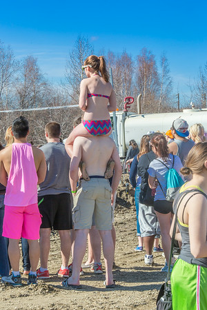 The warm weather during the SpringFest 2014 mud volleyball bouts brought out bikinis and tanktops among the spectators.  Filename: LIF-14-4167-16.jpg