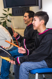 Justin Bill, left, and Chase Alexie beat the drums for the KuC Yuraq Dance Group as they practice in the school's conference room on March 30, 2016 in preparation for their upcoming appearance at the Cama-i Dance Festival in Bethel.  Filename: LIF-16-4859-340.jpg