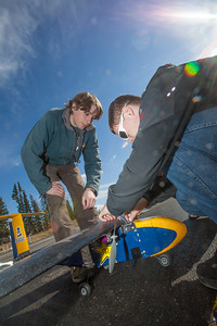 Engineering students Sam Brewer, left, and Corey Upton adjust their model plane before sending it aloft for a test flight over a parking lot on the Fairbanks campus.  Filename: LIF-12-3366-001.jpg