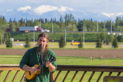 Local musician Ukulele Russ entertained a nice crowd during UAF Summer Session's free Music in the Garden concert series June 12.  Filename: LIF-14-4209-64.jpg