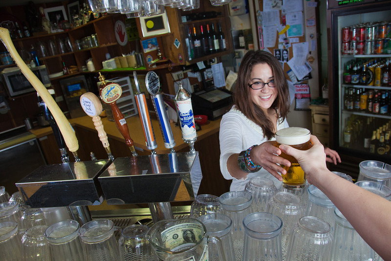 """Senior Kelley Ryan serves up a cold beer in UAF's Wood Center Pub.  <div class=""""ss-paypal-button"""">Filename: LIF-11-3217-105.jpg</div><div class=""""ss-paypal-button-end"""" style=""""""""></div>"""