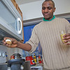 "Peter Ikewun, a petroleum engineeering graduate student from Nigeria, prepares a traditional African soup in his communal Wickersham Hall kitchen.  <div class=""ss-paypal-button"">Filename: LIF-12-3268-028.jpg</div><div class=""ss-paypal-button-end"" style=""""></div>"