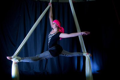 Lindsey Dreese is an active member of the silk club at UAF, in which members perform acrobatic stunts hanging from silks.  Filename: LIF-14-4133-16.jpg