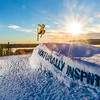 """Students enjoy some of the features of UAF's terrain park on a spring afternoon.  <div class=""""ss-paypal-button"""">Filename: LIF-13-3746-33.jpg</div><div class=""""ss-paypal-button-end"""" style=""""""""></div>"""
