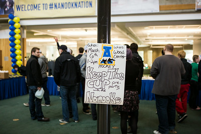Lauren Bradley makes a poster supporting the Alaska Nanooks Hockey team during the Keep the Cup Preparty rally at the Wood Center.  Filename: LIF-14-4103-7.jpg