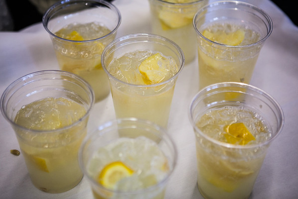 """Chancellor Rogers with wife, Sherry Mudrow serve lemonade during staff appreciation's indoor barbecue at Lola Tilly Commons.  <div class=""""ss-paypal-button"""">Filename: LIF-13-3832-26.jpg</div><div class=""""ss-paypal-button-end"""" style=""""""""></div>"""