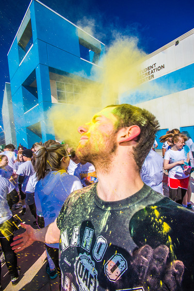 """Students enjoy getting doused with colored dye before participating in a 5-kilometer run during SpringFest on the Fairbanks campus.  <div class=""""ss-paypal-button"""">Filename: LIF-13-3805-45.jpg</div><div class=""""ss-paypal-button-end"""" style=""""""""></div>"""