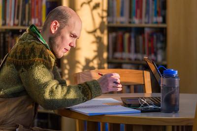 Senior math major David Leonard catches up on some studying on the 5th floor of the Rasmuson Library.  Filename: LIF-14-4045-6.jpg