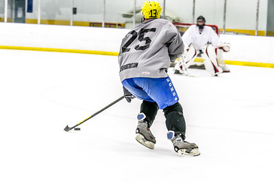 Intramural hockey action on a Tuesday night at the Patty Ice arena.  Filename: LIF-14-4111-378.jpg