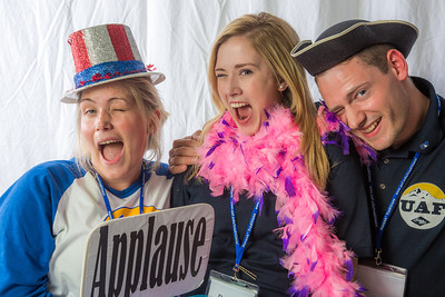 Students pose in the UAF Facebook photobooth during a back-to-school orientation party in the Wood Center.  Filename: LIF-12-3517-132.jpg