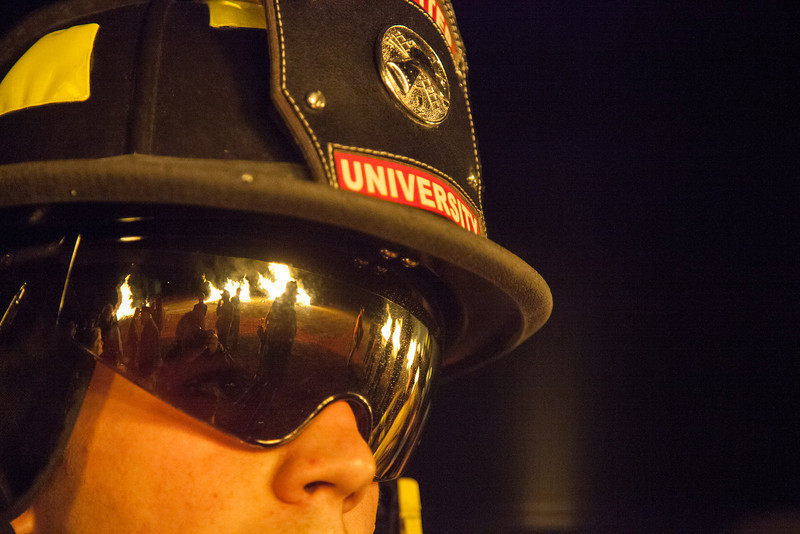 "Starvation Gulch bonfires are reflected on a UFD firefighter's eye protection Saturday, September 29, 2012 at the UAF Taku Parking lot.  <div class=""ss-paypal-button"">Filename: LIF-12-3573-33.jpg</div><div class=""ss-paypal-button-end"" style=""""></div>"