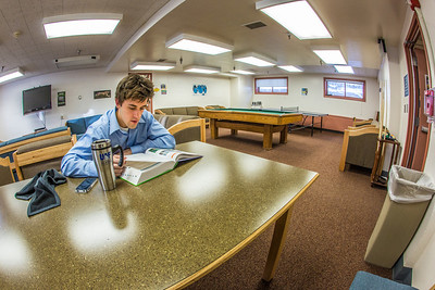 An undergraduate studies for a final in the basement lounge in Lathrop Hall on the Fairbanks campus.  Filename: LIF-13-3737-38.jpg