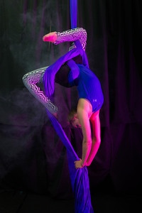 Lindsey Dreese is an active member of the silk club at UAF, in which members perform acrobatic stunts hanging from silks.  Filename: LIF-14-4133-235.jpg