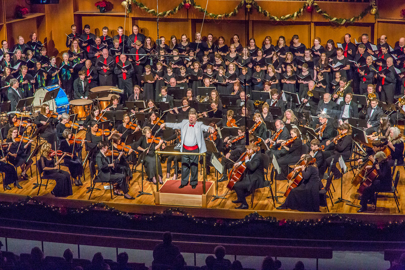 """Conductor Eduard Zilberkant turns around to lead the audience in song during the Fairbanks Symphony's annual holiday concert in the Davis Concert Hall.  <div class=""""ss-paypal-button"""">Filename: LIF-13-4016-163.jpg</div><div class=""""ss-paypal-button-end"""" style=""""""""></div>"""