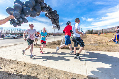 Participants in the Mustache Dash cross the finish line during SpringFest April 28.  Filename: LIF-14-4168-50.jpg