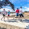"Participants in the Mustache Dash cross the finish line during SpringFest April 28.  <div class=""ss-paypal-button"">Filename: LIF-14-4168-50.jpg</div><div class=""ss-paypal-button-end""></div>"