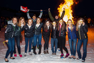 Participants from the 2013 USSA Junior National Cross Country Ski Championships pose for a photo at a bonfire after the awards ceremony at the Student Recreation Center March 16, 2013.  Filename: LIF-13-3760-34.jpg