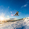 """Students enjoy some of the features of UAF's terrain park on a spring afternoon.  <div class=""""ss-paypal-button"""">Filename: LIF-13-3746-36.jpg</div><div class=""""ss-paypal-button-end"""" style=""""""""></div>"""