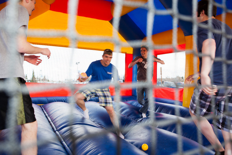 """Students enjoy a variety of inflatable toys and games during the 2012 Spring Fest field day activities.  <div class=""""ss-paypal-button"""">Filename: LIF-12-3384-90.jpg</div><div class=""""ss-paypal-button-end"""" style=""""""""></div>"""