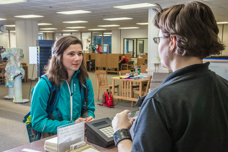 "Sarah King, a junior majoring in elementary education, asks a question at the circulation desk in the Rasmuson Library.  <div class=""ss-paypal-button"">Filename: LIF-14-4045-164.jpg</div><div class=""ss-paypal-button-end""></div>"