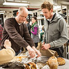 "Ceramics professor Jim Brashear prepares another turkey, which was baked in a kiln while student Ian Wilkinson takes out homemade bread during the annual Thanksgiving gathering at the ceramics department.  <div class=""ss-paypal-button"">Filename: LIF-12-3660-73.jpg</div><div class=""ss-paypal-button-end"" style=""""></div>"