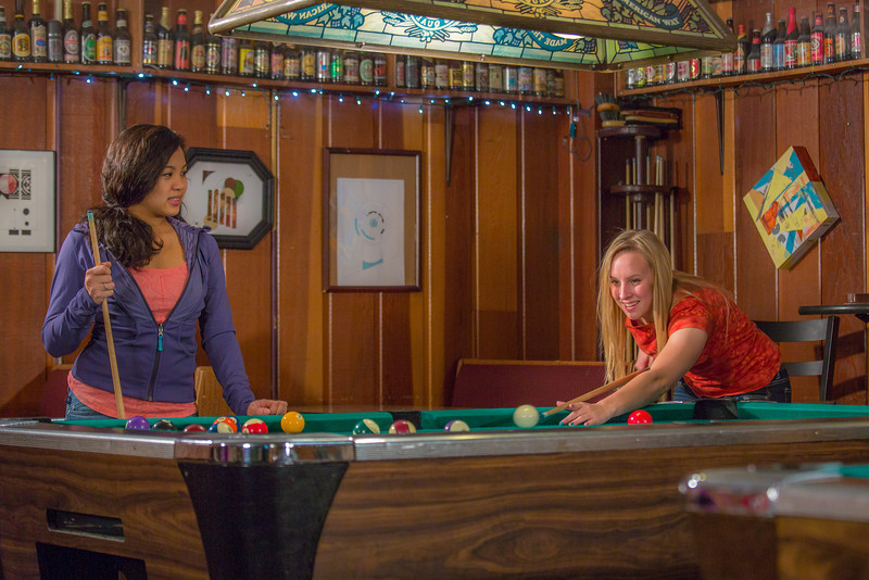 "Students unwind over a game of pool in the Wood Center Pub on the Fairbanks campus. (Note: Taken as part of commercial shoot with Nerland Agency -- use with discretion!)  <div class=""ss-paypal-button"">Filename: LIF-12-3563-031.jpg</div><div class=""ss-paypal-button-end"" style=""""></div>"