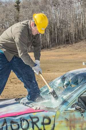 For a fee, participants got to take a turn demolishing a donated car at a Moore Hall fundraiser during UAF's SpringFest Field Day April 28.  Filename: LIF-14-4168-193.jpg