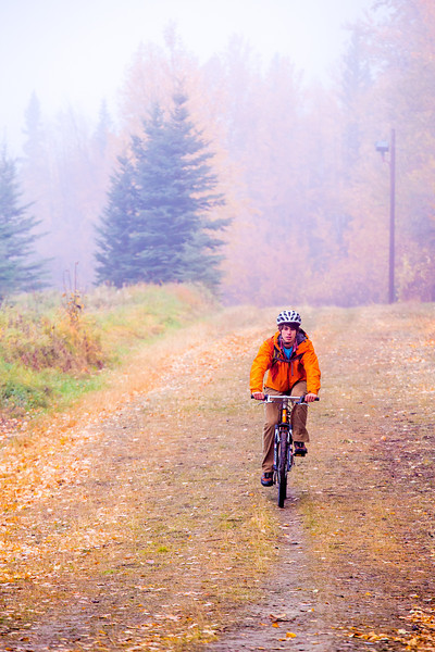 "Mechanical engineering major Adam McCombs rides his bike through the potato field towards campus on a recent foggy morning.  <div class=""ss-paypal-button"">Filename: LIF-12-3556-025.jpg</div><div class=""ss-paypal-button-end"" style=""""></div>"