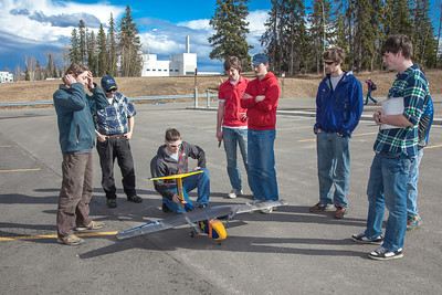 Engineering majors in the UAF Aero Club gather with their model plane before sending it aloft for a test flight over a parking lot on the Fairbanks campus.  Filename: LIF-12-3366-036.jpg