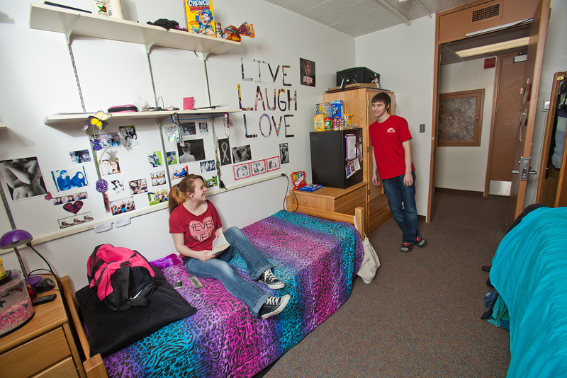 """Freshman Hailley Myers visits with fellow Skarland Hall resident Quinn Verfaillie in her fourth floor room.  <div class=""""ss-paypal-button"""">Filename: LIF-12-3322-183.jpg</div><div class=""""ss-paypal-button-end"""" style=""""""""></div>"""