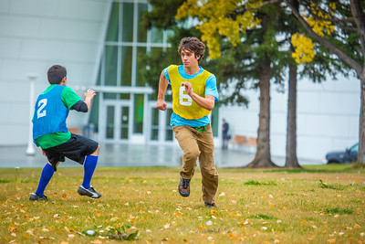 Mechanical engineering major Adam McCombs joins in a bout of utlimate frisbee in the field near the University of Alaska's Museum of the North on a fall afternoon.  Filename: LIF-12-3557-111.jpg