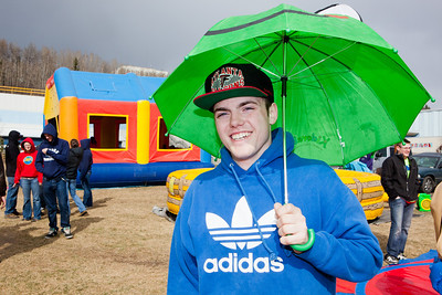 Cameron Dickenson sports an umbrella as the weather turned for the worst during the 2012 Spring Fest field day activities.