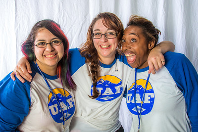 Students pose in the UAF Facebook photobooth during a back-to-school orientation party in the Wood Center.  Filename: LIF-12-3517-155.jpg