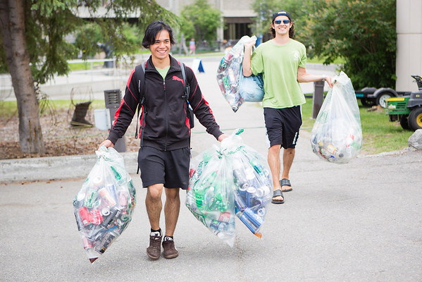 """UAF Sustainability student workers: Jeric Quiliza (left) and Rodney Carpluk collect aluminum cans around campus for recycling.  <div class=""""ss-paypal-button"""">Filename: LIF-12-3451-2.jpg</div><div class=""""ss-paypal-button-end"""" style=""""""""></div>"""