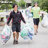 "UAF Sustainability student workers: Jeric Quiliza (left) and Rodney Carpluk collect aluminum cans around campus for recycling.  <div class=""ss-paypal-button"">Filename: LIF-12-3451-2.jpg</div><div class=""ss-paypal-button-end"" style=""""></div>"