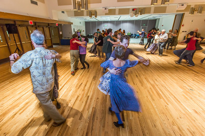Members of the Fairbanks community joined UAF students and staff for a Contra Dance in the Wood Center Ballroom as part of the 2014 Winter Carnival on campus.  Filename: LIF-14-4085-17.jpg