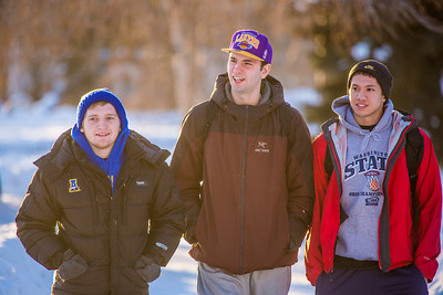 Colton Anderson, left, Mike Stepo, center and Anthony Reese walk to class after having lunch in the Commons on the first day of classes in the spring 2013 semester.  Filename: LIF-13-3699-57.jpg