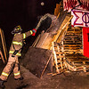 "A student with the University Fire Department douses one of the bonefire structures with gasoline moments before they were torched during traditional Starvation Gulch activities Sept. 29.  <div class=""ss-paypal-button"">Filename: LIF-12-3571-070.jpg</div><div class=""ss-paypal-button-end"" style=""""></div>"