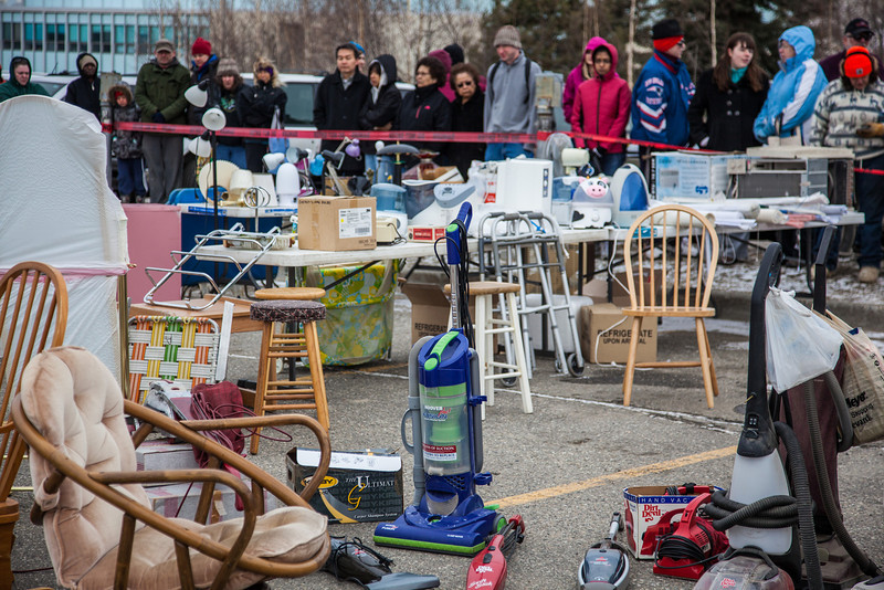 """People brave the cold at the Really Free Market, May 18, 2013 on campus.  <div class=""""ss-paypal-button"""">Filename: LIF-13-3844-14.jpg</div><div class=""""ss-paypal-button-end"""" style=""""""""></div>"""