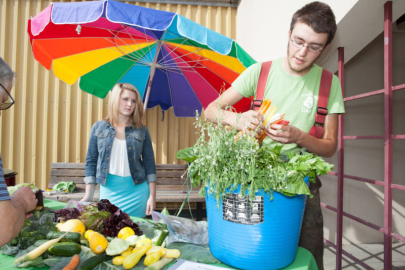 """Students Alexander Bergman, right, and Katie Luper, sell a variety of organic vegetables grown on campus to students, faculty, and community members Thursday, August 23, 2012 in front of the Wood Center. Sustainable UAF will continue to sell vegetables until the weather gets too cold.  <div class=""""ss-paypal-button"""">Filename: LIF-12-3499-15.jpg</div><div class=""""ss-paypal-button-end"""" style=""""""""></div>"""