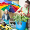 "Students Alexander Bergman, right, and Katie Luper, sell a variety of organic vegetables grown on campus to students, faculty, and community members Thursday, August 23, 2012 in front of the Wood Center. Sustainable UAF will continue to sell vegetables until the weather gets too cold.  <div class=""ss-paypal-button"">Filename: LIF-12-3499-15.jpg</div><div class=""ss-paypal-button-end"" style=""""></div>"