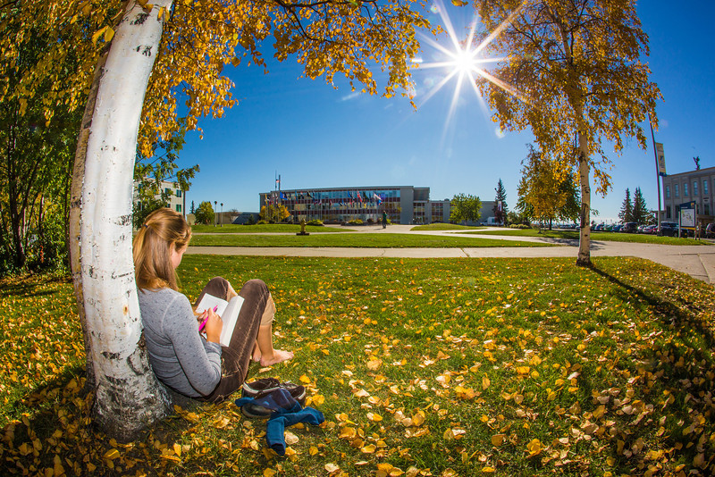 """Emily Russell, a new graduate student in Northern Studies, takes advantage of nice September weather on the Fairbanks campus.  <div class=""""ss-paypal-button"""">Filename: LIF-12-3540-02.jpg</div><div class=""""ss-paypal-button-end"""" style=""""""""></div>"""
